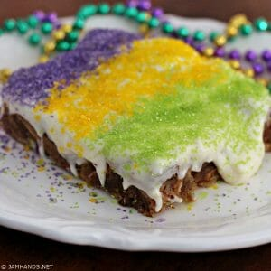 King Cake Bread Pudding with Bourbon Cream Cheese Frosting
